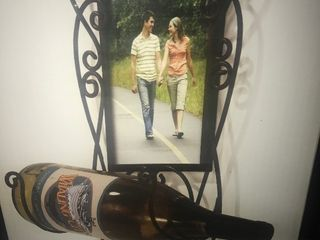 Metal photo wine bottle holder as pictures