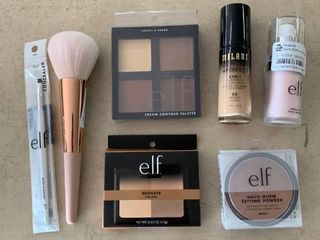 Beauty lOT  Sonia Kashuk Powder Brush  elf Concealer Brush  elf Cream Contour   Bronzer Palettes  elf Halo Glow Setting Powder   Poreless Face Primer   Milani Foundation  RETAIl  49