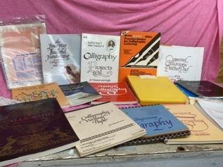 ASSORTMENT OF CAllIGRAPHY BOOKS AND ZIPPY SIGN