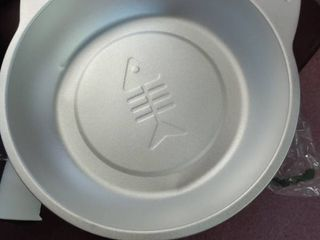 large aluminum pans with fish on the bottom