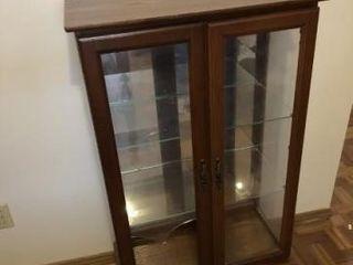 Vintage wooden curio cabinet  lighted