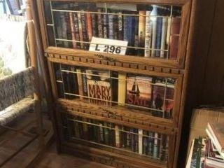 Wooden book shelf with glass front door