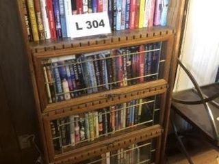 Wooden book shelf w  glass front doors