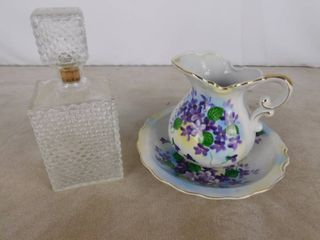 Glass bottle with cork lid and beautiful wash bowl pitcher  bowl has chip see pics