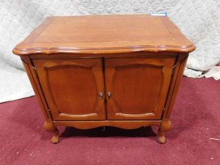 2 door end table 22 in H X 25 in W X 16 in l  has damage to the back see pics