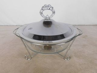 Casserole dish with lid on a warming stand