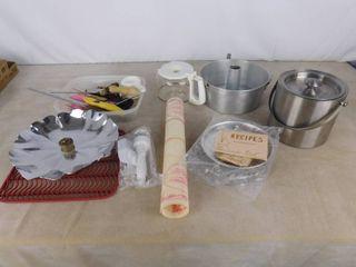 Tupperware silicone dough mat  angel food cake pan  sink mat  smoke rack and aluminum decorative bowl