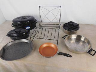 Set of 2 roasting dishes  cookbook holder  veggie slicer and 2 pans