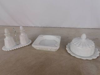 4 piece assorted Westmoreland paneled grape milk glassware including an ashtray and candy dish with lid and unmarked cruet with stopper on a stand
