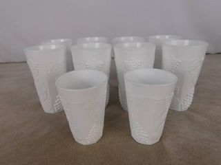 Set of 8 paneled grape milk glass cups 6 in H and a pair of grape paneled cups 4 1 2 in H  unknown name