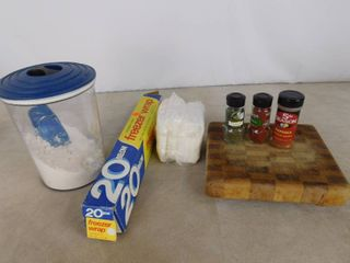 lot of kitchenware including large canister with lid  freezer wrap  napkins and seasonings