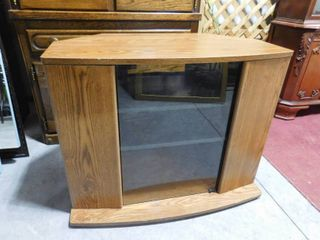 Small entertainment center with glass door 35 in W X 28 in H X 19 in D