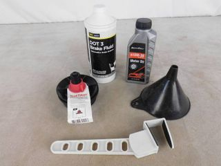Motor oil  brake fluid  both opened  funnel and mechanical test plug