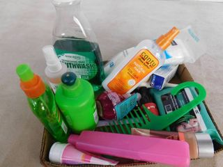 lot of hygiene items including mouthwash  straightening cream  conditioning cream  comb  bobby pins and face wipes
