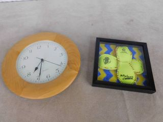 Wall hanging clock and Women s NCAA College World series signed and framed softball