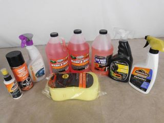 lot of automotive supplies including car washing sponge  3 bottles of wash   wax  interior detailer and tire shine