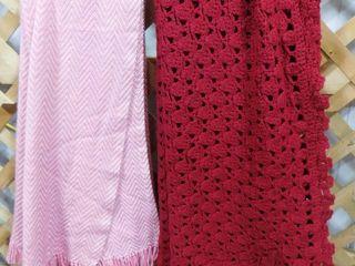 Burgundy knit blanket and pink knit blanket