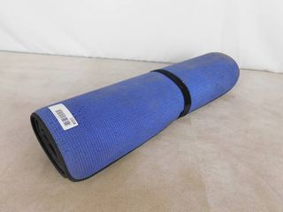 Blue padded yoga mat with strap