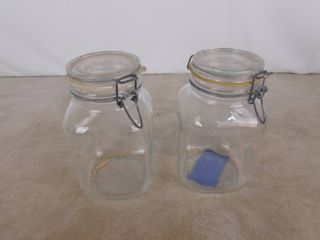 Pair of glass canisters with clamp lids