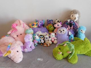 large lot of stuffed animal s and blankets