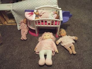 lot of doll s and baby changing toy station