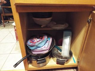1 cabinet and 2 Drawers full of utensils   pots  pans  Glass platers  2 cushions floor mats and more