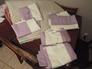 lot of white and purple stripped curtains