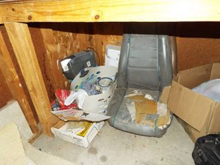 Contents under table  Radio  File folders  Paint  2 Odd car seats  Speaker box cover  Dishes  Suit case and more