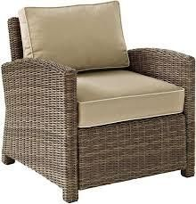 Bradenton Outdoor Arm Chair wicker weathered brown with cream cushions as is