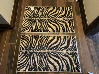 2   Zebra Print Rugs