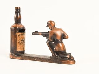 VINTAGE SOUTHERN COMFORT WHISKEY MECHANICAl BANK