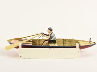 TIN lITHO WIND UP ROW BOAT  612   HOMEMADE CRADlE