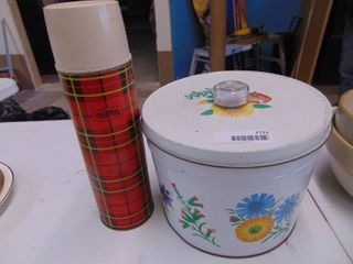 A Metal Tin and Thermos