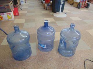 3 plastic 5 gallon water jugs