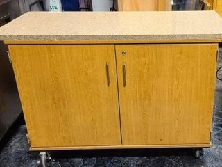 Wood Cabinet on casters with Granite top