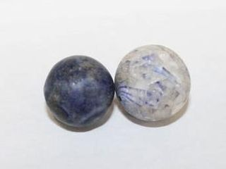 2 medium sized blue bennington marbles