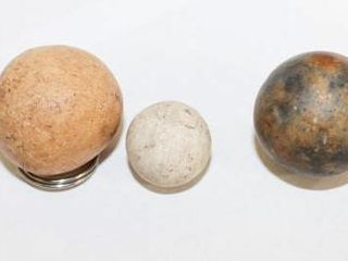 3   Clay Marbles different sizes