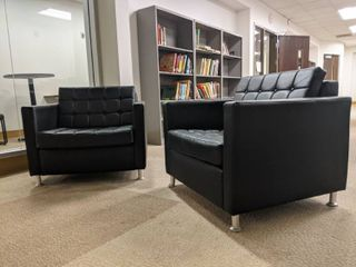2  Black Cushioned Chairs