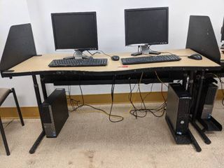 Desk With Two Dell Computers