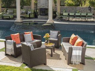 Jacksonville Outdoor 5 piece Wicker style Chat Set with Sofa and Cushion by Christopher Knight Home   Retail 899 49