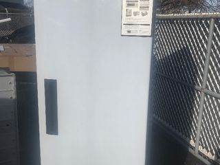 New single door commercial refrigerator on casters as pictured
