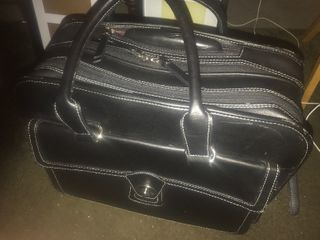 Very nice travel case with built in wheels and pull unit shoulder strap great for traveling looks very nice