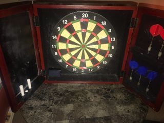 Medium size enclosed dart board with picture front wheel hold for pictures