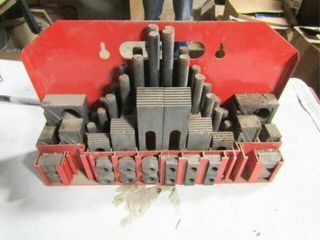 Mill hold down tool set with metal carrier