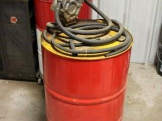 Empty 55 gal barrel  with GPI Hand pump on dolly