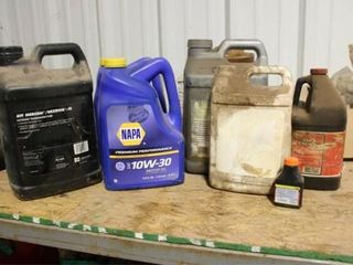 5 ea plastic jugs assorted oil products