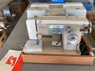 DRESSMAKER MODEl KNS 1000 SEWING MACHINE AND