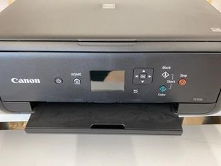 CANON  NEVER USED PRINTER  MANUAl IS ON lINE