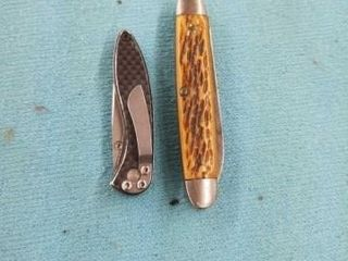 1 ClIP ON POCKET KNIFE AND A POCKET KNIFE