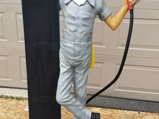 Gas station attendant with chalkboard  lifesize